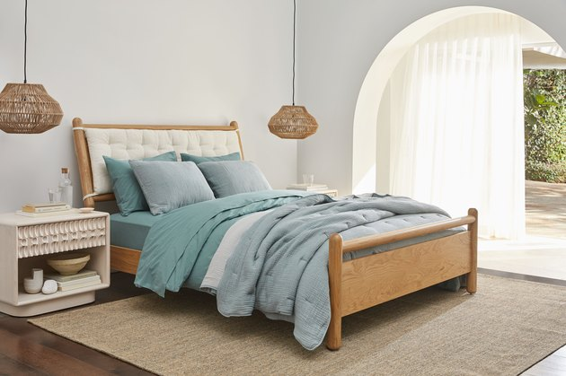 bed with blue linens
