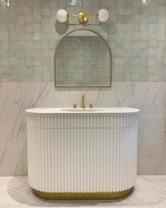 Bathroom Trends 2021 green and white bathroom with fluted vanity unit