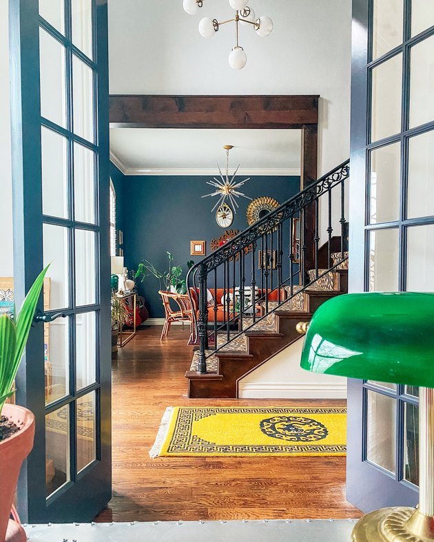 Sarisa Munoz The Indigo Leopard Home with French doors overlooking staircase