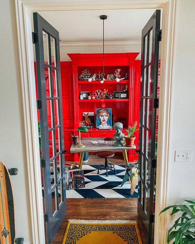 Sarisa Munoz The Indigo Leopard Home office with black and white floor tile and red cabinetry