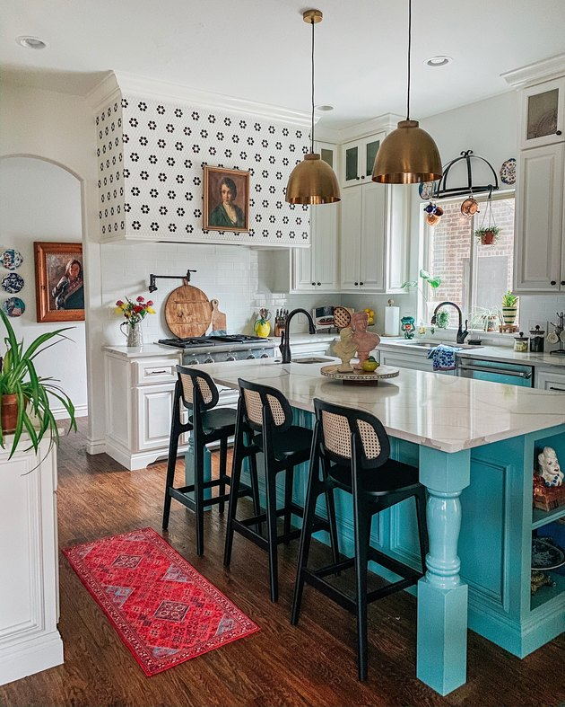 Sarisa Munoz The Indigo Leopard Home kitchen with turquoise island and white cabinets