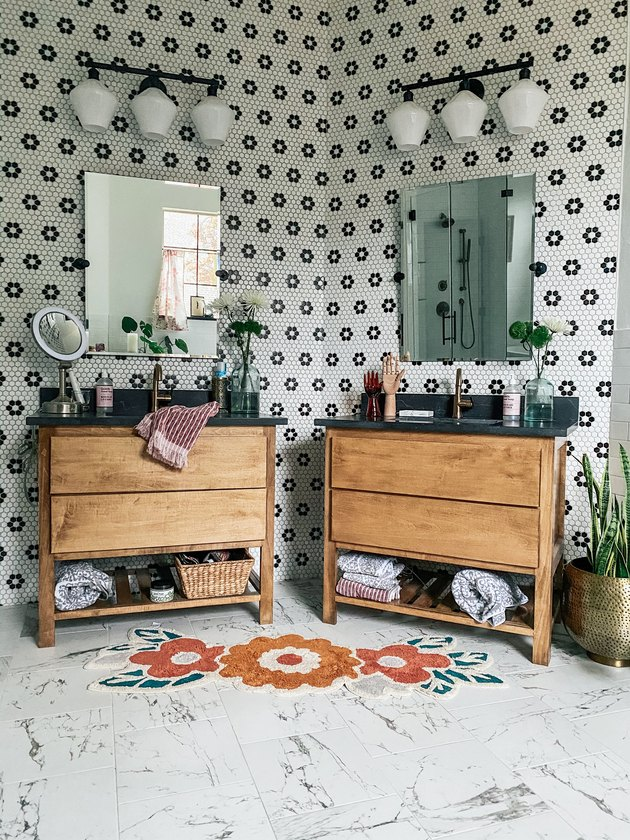 Sarisa Munoz The Indigo Leopard Home bathroom with black and white mosaic tile walls