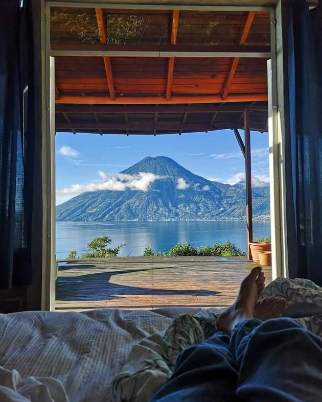 view from a lodge of a volcanic crater and water