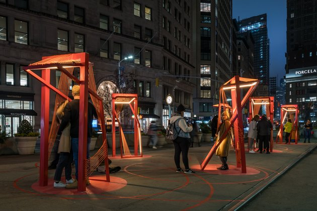 photo of architectural project with people underneath read structures in a cityscape