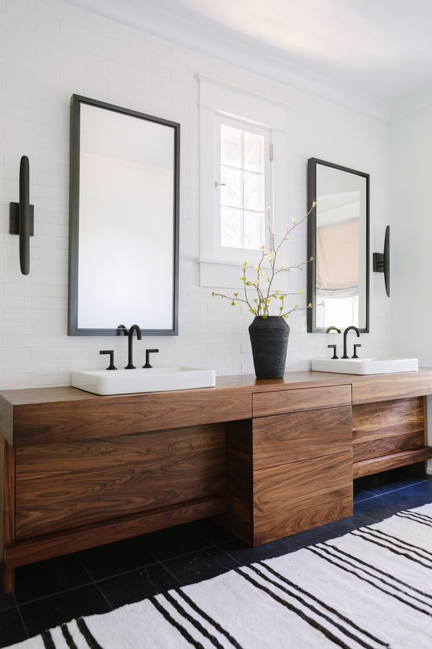 Bathroom Trends 2021 white bathroom with wooden vanity and black taps