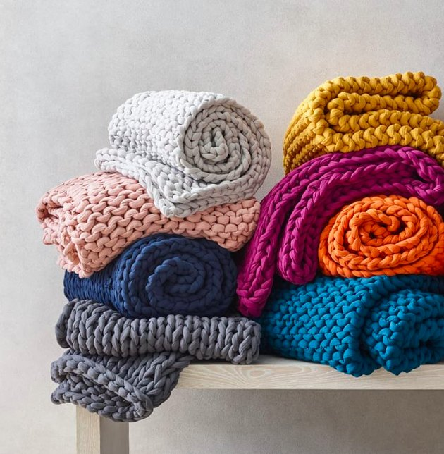 Colorful blankets rolled on a bench