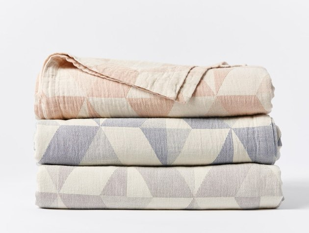stacked geometric pastel blankets