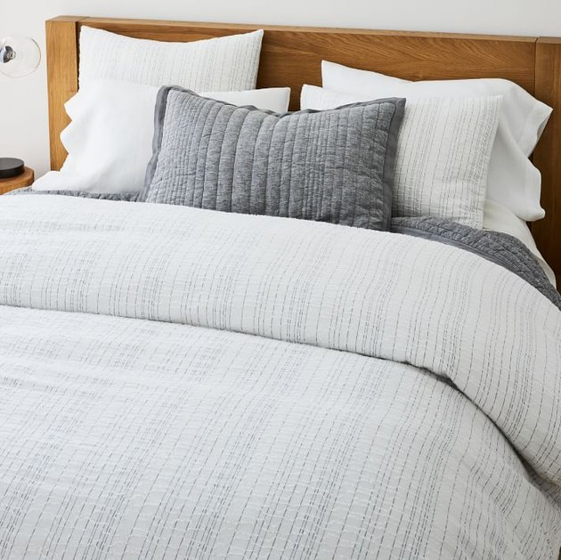 bed with gray bedding