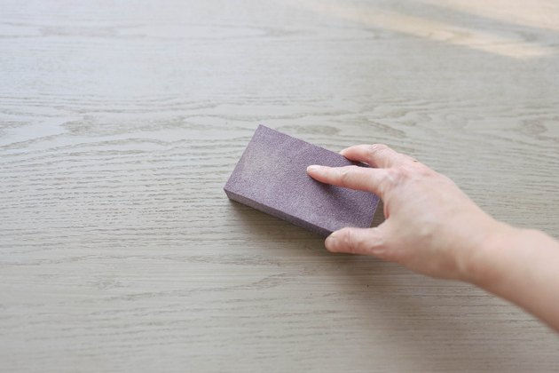 Sanding desk surface with sanding sponge