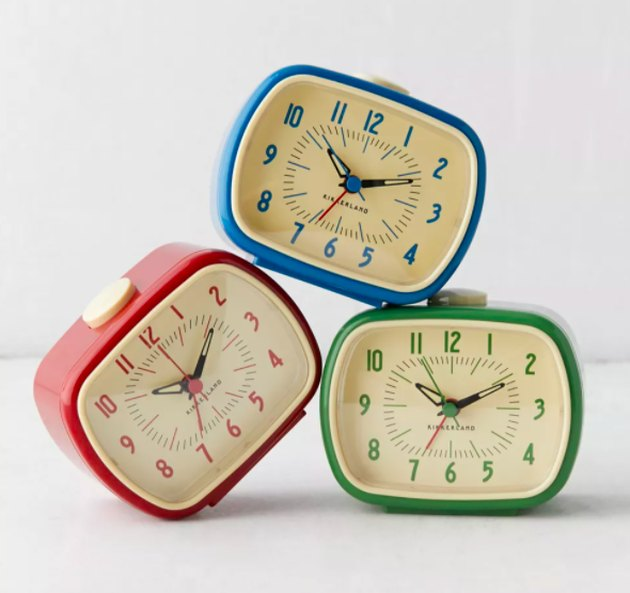 3 analog retro clocks stacked together