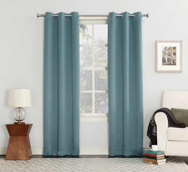 teal blackout curtains in living room