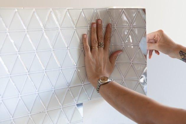 white peel-and-stick tile backsplash