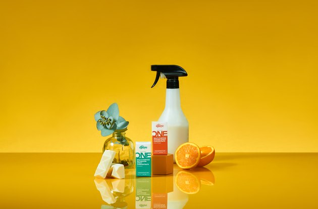 solid cleaning supplies with yellow background