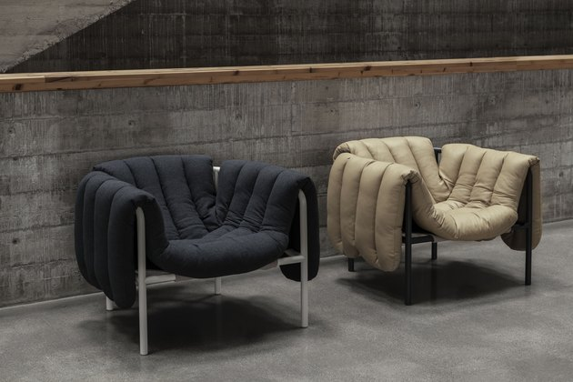 two puffy lounge chairs in black and tan