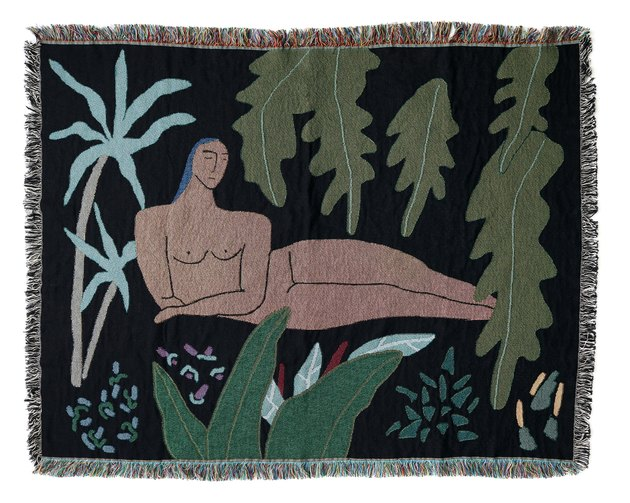 blanket with figure and leaves