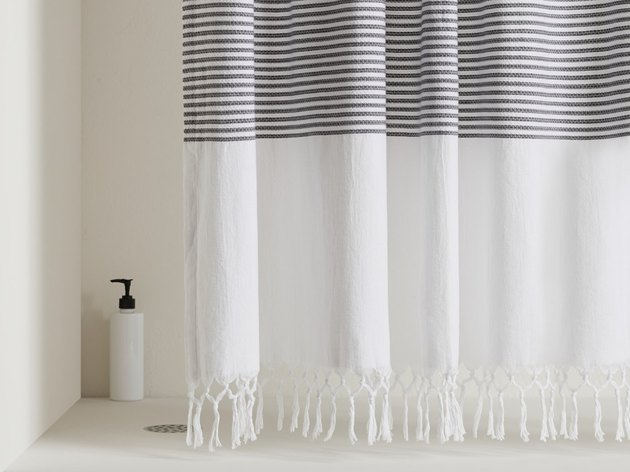 Turkish eco-friendly shower curtain with gray stripes and hand-knotted fringe