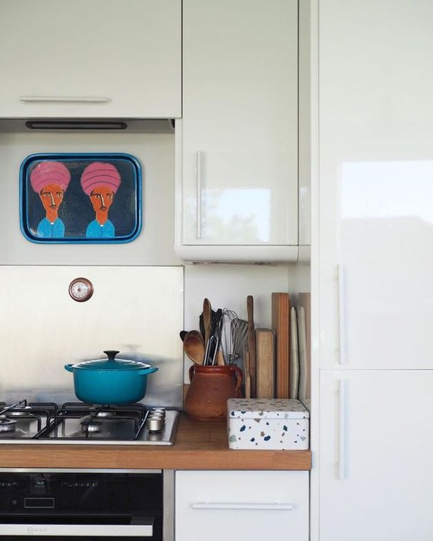 Eco-Friendly Interior Design in kitchen with secondhand artwork and crockery