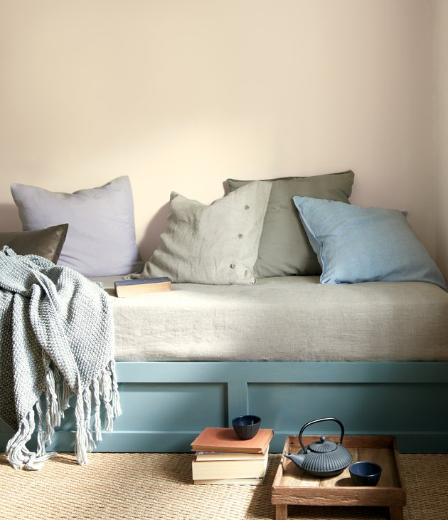 bench with pillows and teal bottom