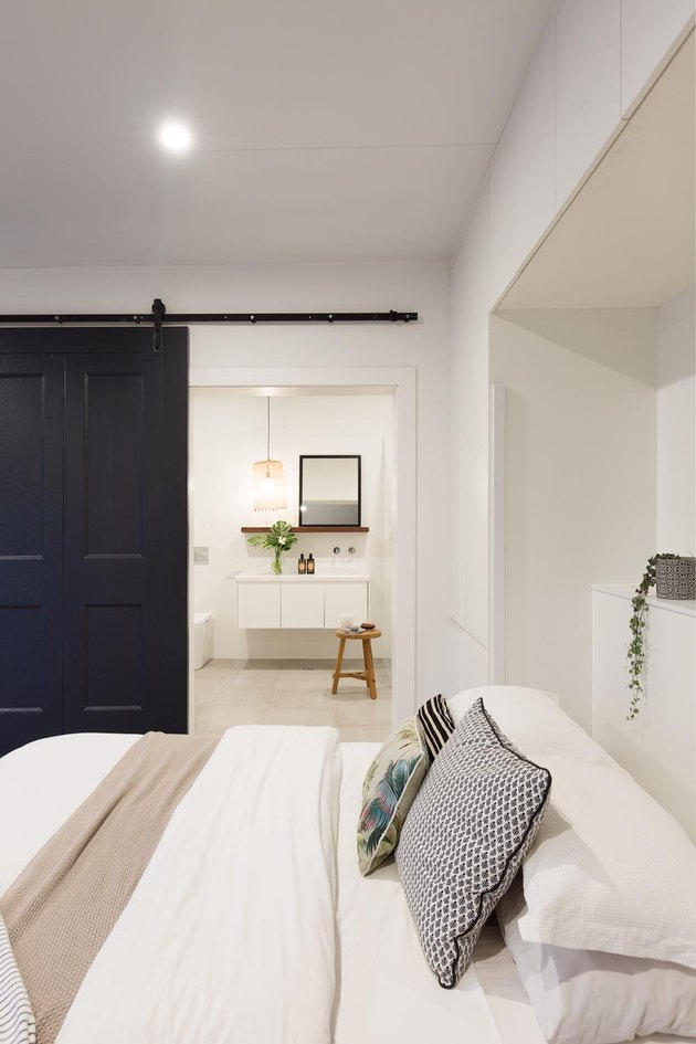black and white converted garage bedroom idea with barn door