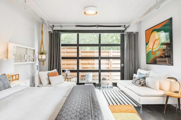 converted garage bedroom idea with see-through door
