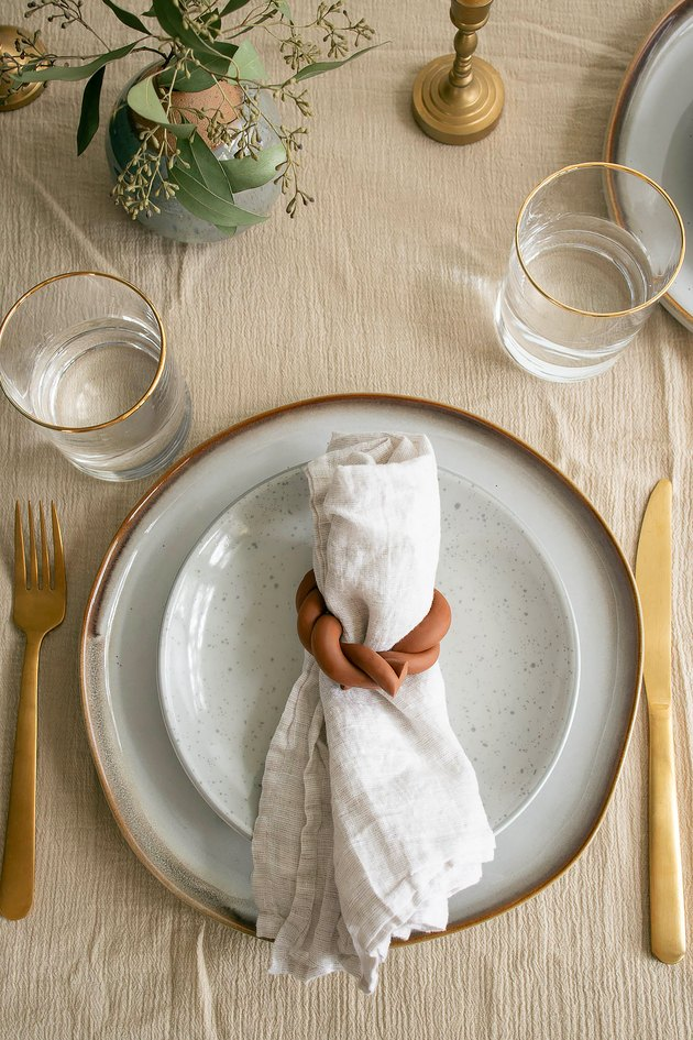 Plate setting with linen napkin inside a DIY twisted clay napkin ring