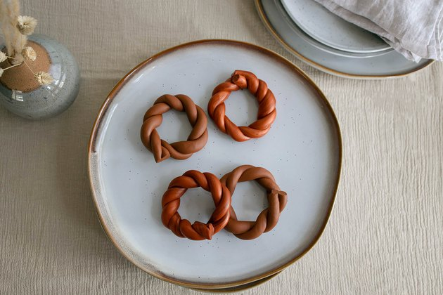 DIY twisted clay napkin rings in terra cotta colors