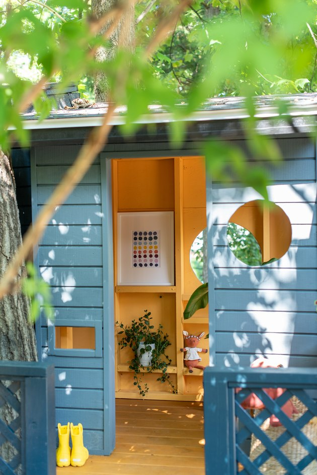 Outdoor playhouse with toy storage
