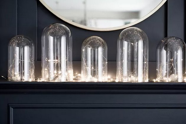 Create a Warm Holiday Display Using Glass Cloches and Lights