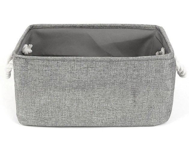 Gray fabric storage container with white rope handles