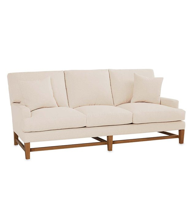 beige eco-friendly couch with wood legs from Viva Terra