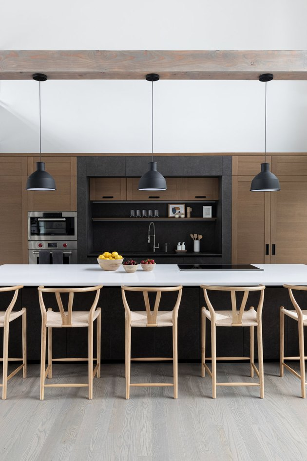 Modern kitchen design with an island stovetop designed by Chango & Co.