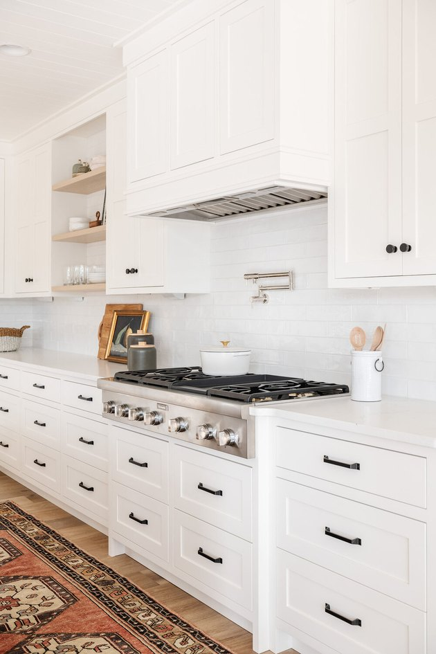 simple white kitchen with white stove and gas stovetop