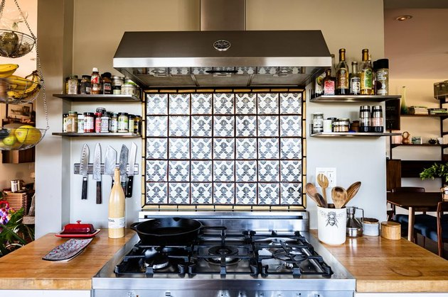 gas stovetop with feature tiled backsplash