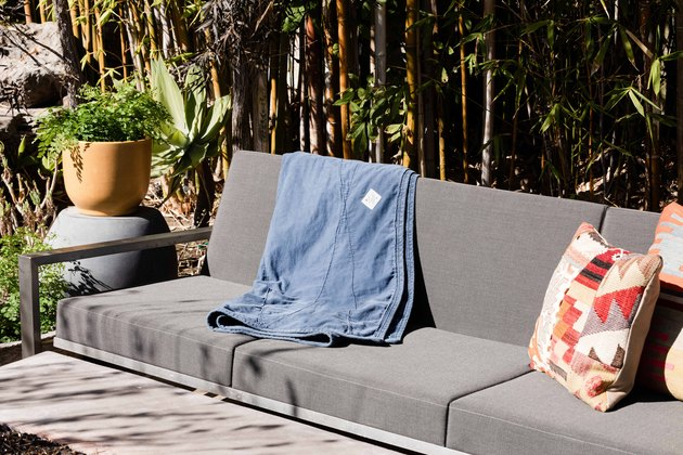 Blanket on outdoor patio couch