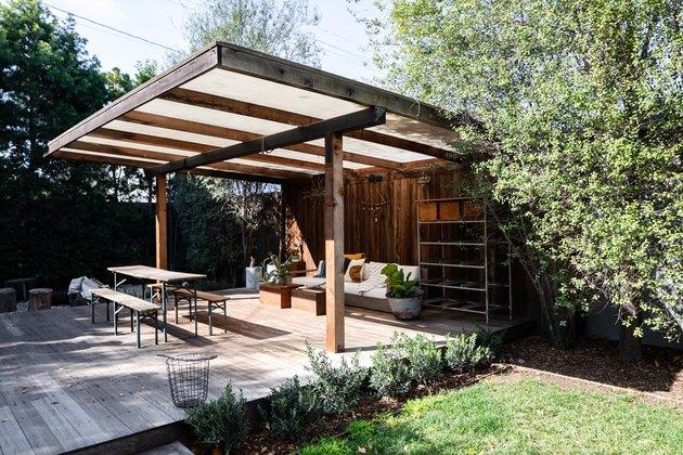 Pergola in backyard over outdoor seating area