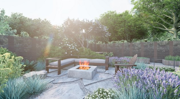 Backyard patio area with fire pit and couch