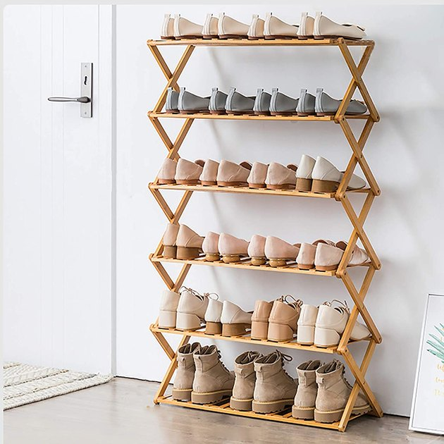 Wood folding shoe organizer by front door.