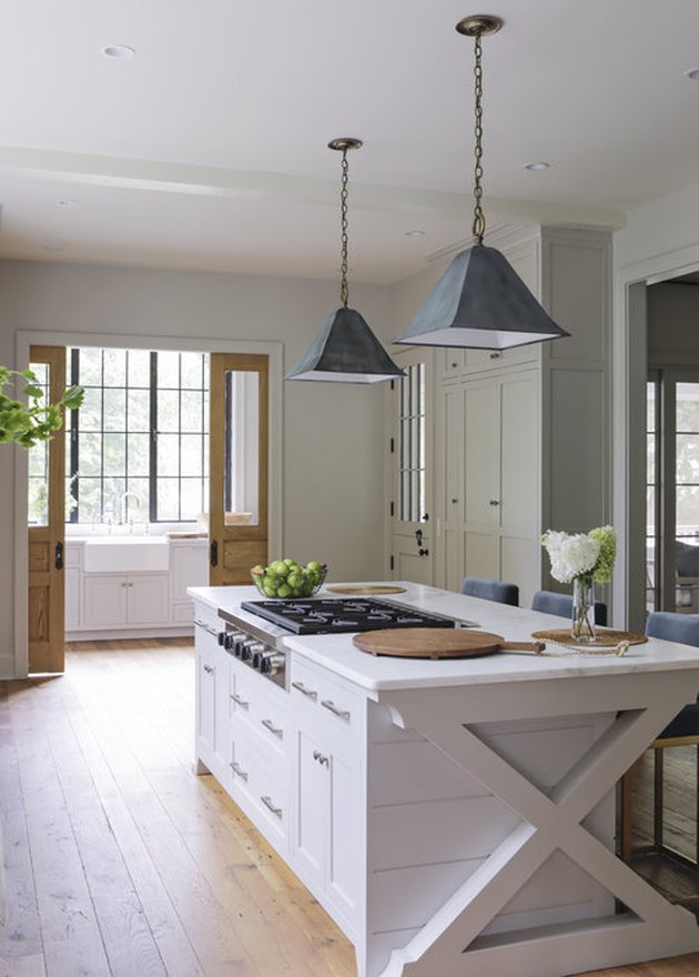 Farmhouse style kitchen with an island stovetop designed by Rachel Halvorson.