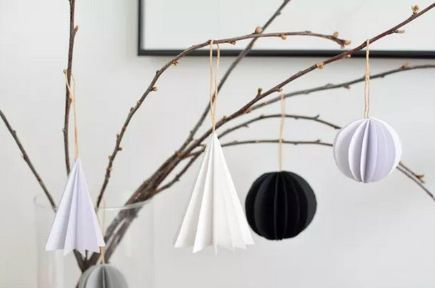 Folded paper ornaments hanging on branch