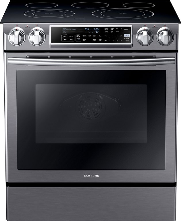 Stainless steel and black glass top electric stove with handle and knobs