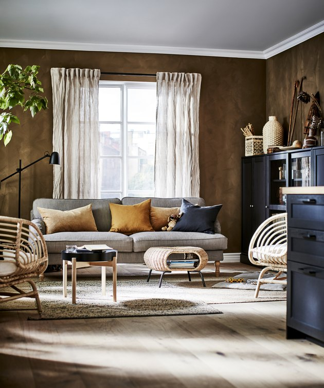 living room with natural materials and dark brown walls