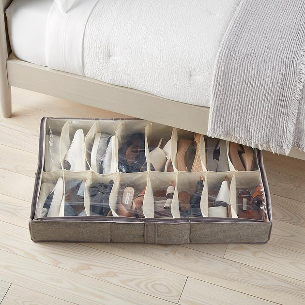 Under bed shoe organizer, bed frame, white bedding.