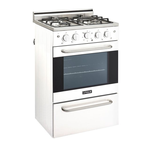 Black and white small gas stove with stainless steel details and drawer