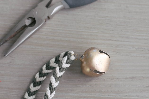 Attaching brass bell to garland with jump ring