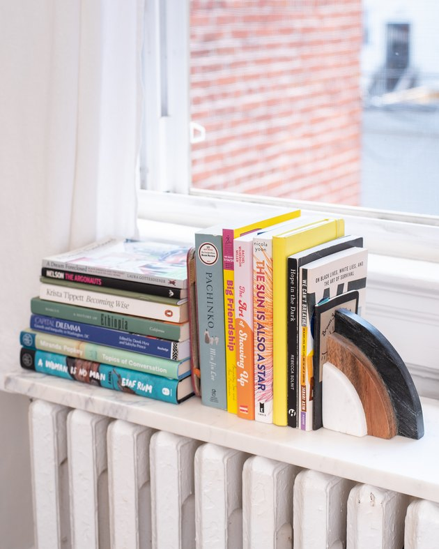 book storage ideas with a marble shelf on top of a radiator makes a small bookshelf.