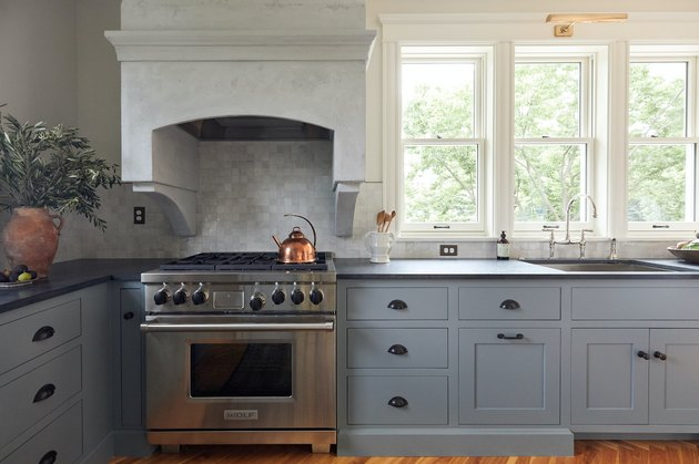 Kitchen with blue cabinets and Wolf oven and stove designed by Prospect Refuge Studio eco-friendly stove oven