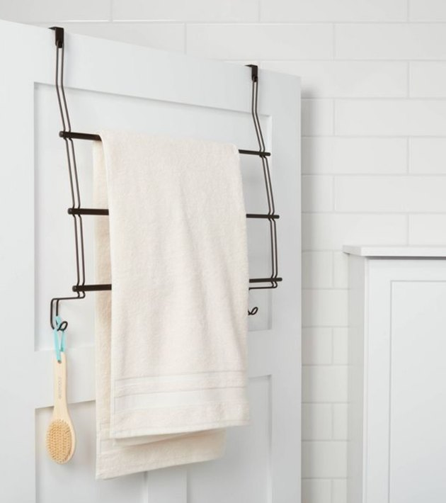 Over the Door Storage with Towel hanging on over the door rack.
