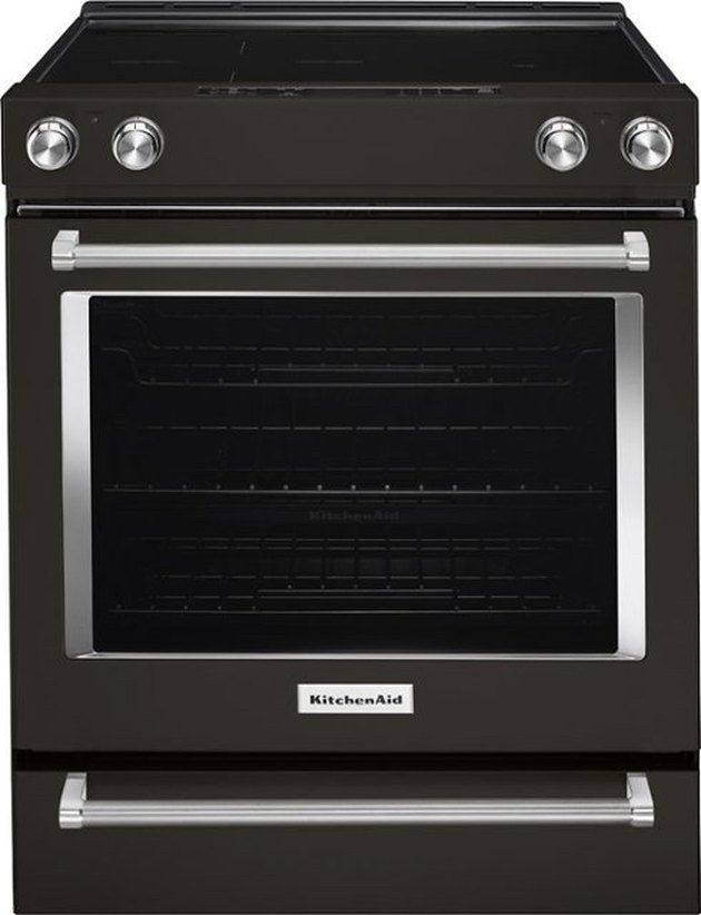 Black glass top electric stove with stainless steel details