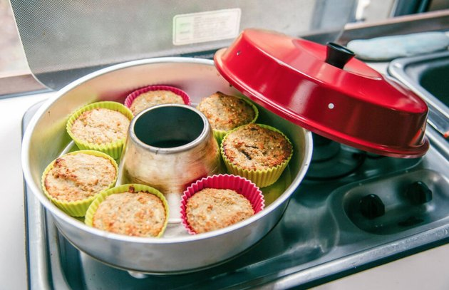 Stove top oven with muffins inside. small stove size