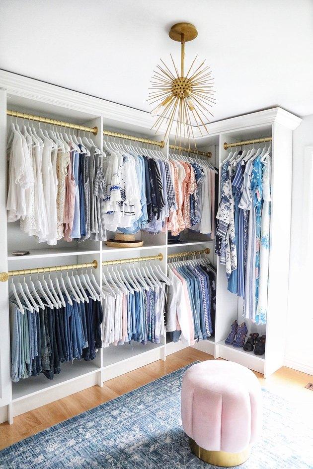DIY Closet Organizer Ideas in organized closet with gold accents